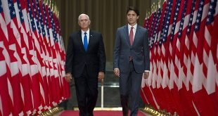 U.S. Vice President Mike Pence, left, and Canadian Prime Minister Justin Trudeau make their way to a joint news conference in Ottawa, Ontario, Thursday, May 30, 2019. (Adrian Wyld/The Canadian Press via AP)